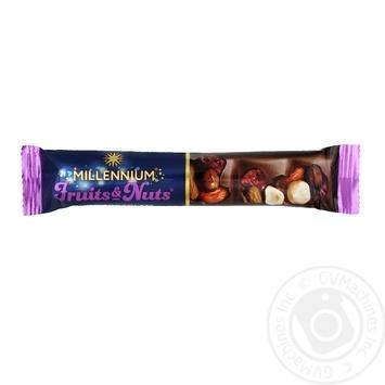 Шоколад молочный Millennium Fruits&Nuts с миндалем, целыми лесными орехами, клюквой и изюмом 35г - купить, цены на Novus - фото 1