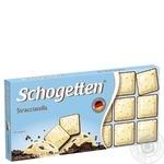 Шоколад білий Schogetten зі шматочками смажених подрібнених какао-бобів та чорним шоколадом 100г