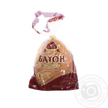 Батон Царь Хлеб Нива (нарезка) половинка 250г - купить, цены на Novus - фото 1