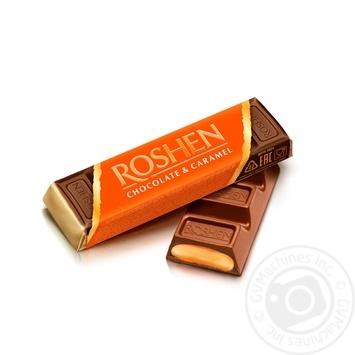 Батончик Roshen молочно-шоколадный с карамельной начинкой 40г - купить, цены на МегаМаркет - фото 1
