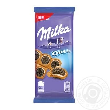 Шоколад Milka молочний з круглим печивом Оrео з начинкою зі смаком ванілі 92г - купити, ціни на Ашан - фото 1