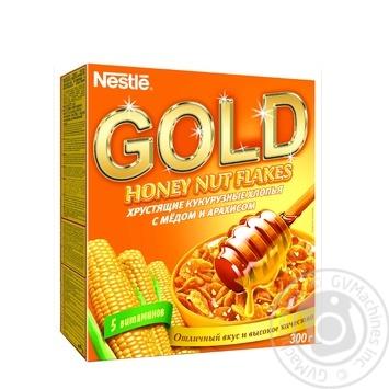 Хлопья кукурузные Нестле Голд с медом и арахисом 300г Польша