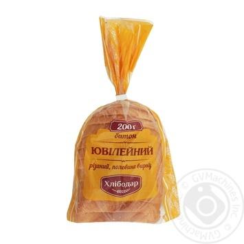 Батон Хлібодар Ювілейний різаний половина 200г - купити, ціни на Ашан - фото 1