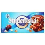 Шоколад молочний ORION® Studentská з арахісом, шматочками желе та родзинками 180г