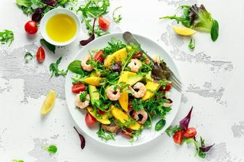 Light salad with tiger shrimps and avocados